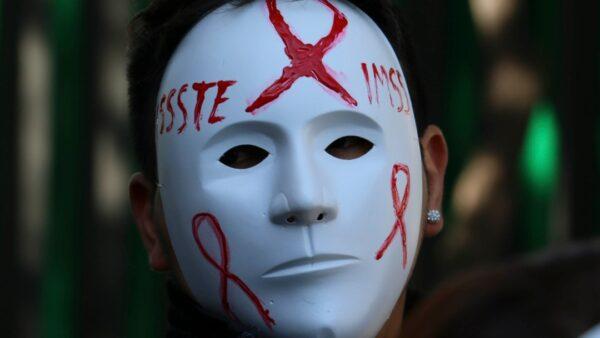 despido sida vih hombre mascara